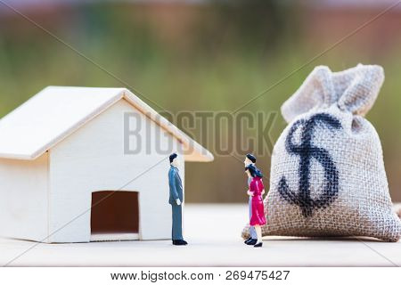 Home Bargain, Real Estate, Loan, House Lender Reverse Mortgage Concept : Three Miniature Bargain Fro