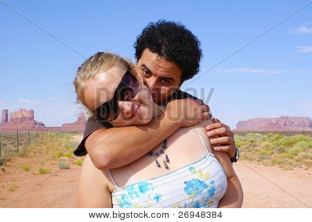 Couple hugging in Monument Valley Tribal Park