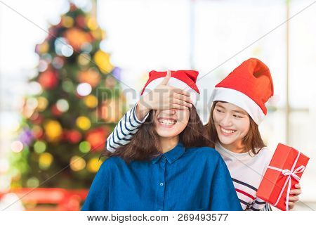Asian Woman Couple,girlfriend Close Eyes By Hand To Surprise Friend By Giving Christmas Gift In Part