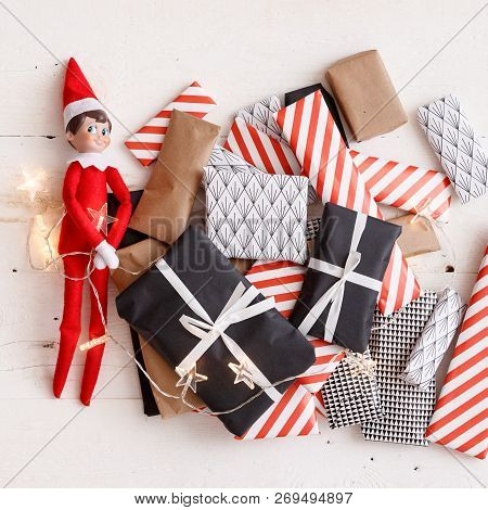 Closeup Of A Funny Christmas Elf On A Background Of Gifts. Festive Season.