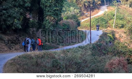 Kathmandu, Nepal - November 18 2018: Group Of People Or Friends Walking Uphill For A Hike.