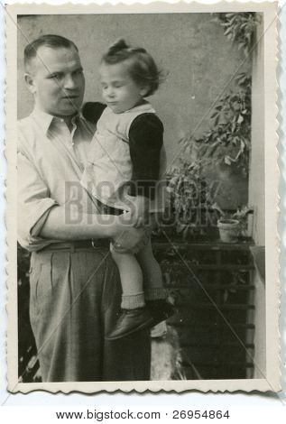 Vintage unretouched photo of father and daughter outdoor