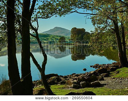 Bala Lake Or Llyn Tegid, Bala, Snowdonia. Picturesque Landscape Scene Of Bala Lake With Clear Blue S