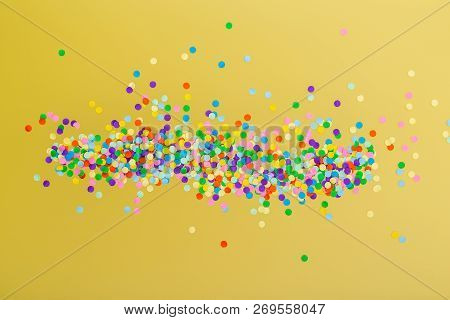 Colorful Confetti On Color Background For Carnival Or Birthday.