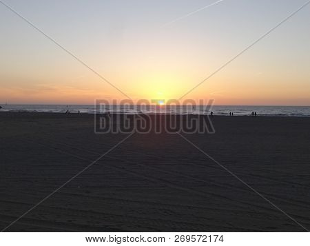 Photo Of Sunset Over The Sea Coast