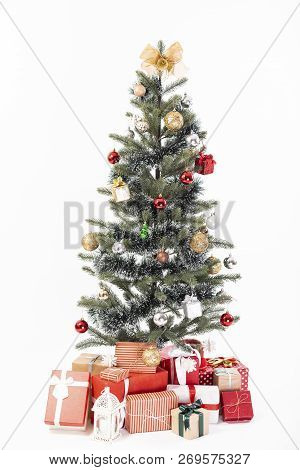 Decorated Christmas Tree With Gift Wrapped Presents Isolated On A White Background.
