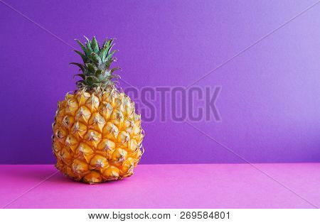 Pineapple Fruit On Violet Purple Background. Copy Space.