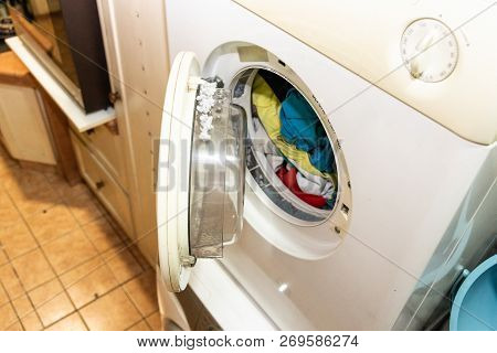 Lint Trapped In Filter Of Laundry Dryer Machine After Drying