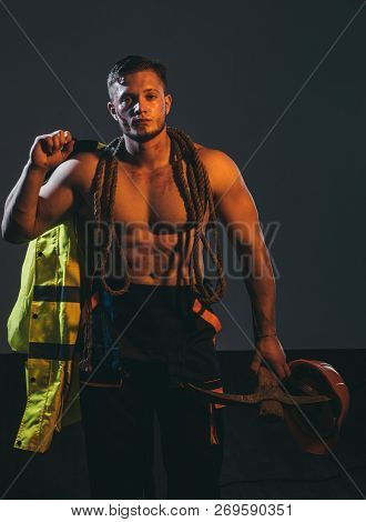 The Object Is Under Construction. Muscular Man Worker. Hard Worker With Muscular Torso. Construction