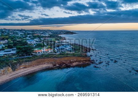 Mornington Peninsula fractional coastline at cloudy sunset poster