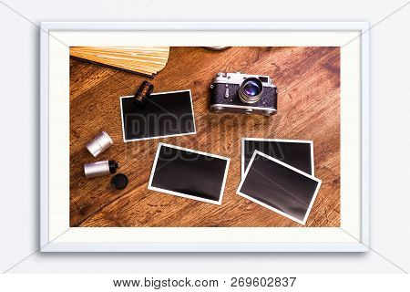 Vintage Photo Camera. Blank Photo Frames. Old Aged Album And Camera Rolls. Wooden Rustic Background.