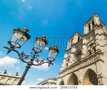Lamppost By Notre Dame Cathedral In Paris, France