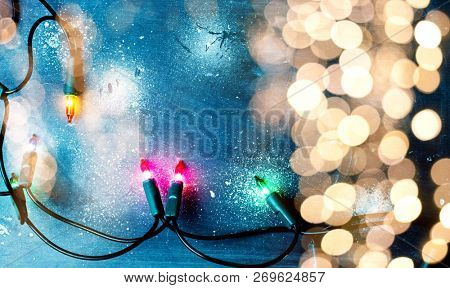 christmas lights over dark blue background with copy space