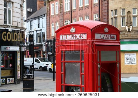 Doncaster, Uk - July 12, 2016: Red Telephone Booth With Atm In Downtown Doncaster, Uk. It Is One Of