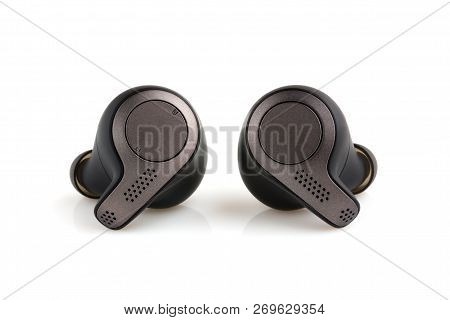 Wireless Headphones On A White Background. Wireless Headset Closeup Isolated On White Background.