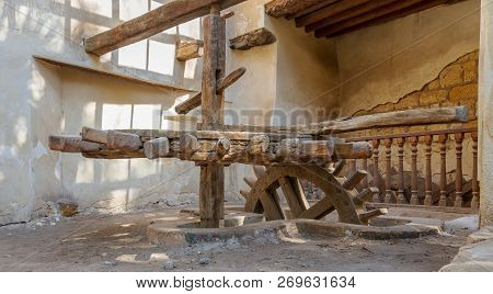 Cairo, Egypt - November 3 2018: Ancient Rotary Flour Mill Used To Be Rotated By Animal Power In Fron