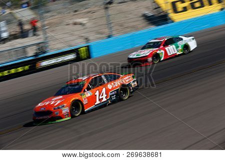 November 11, 2018 - Avondale, Arizona, USA: Clint Bowyer (14) battles for position during the Can-Am 500(k) at ISM Raceway in Avondale, Arizona.