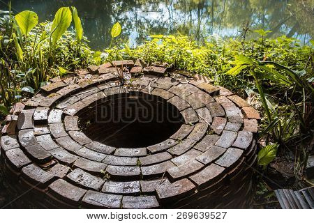 An Ancient Pond Was Built Beside The River. Made Of Clay Bricks. Put It Around The Pond.