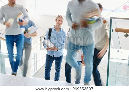 Young students in hectic in university at uni staircase