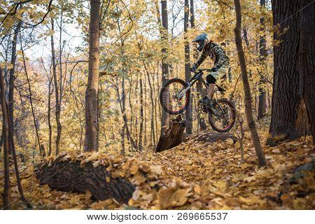 Image of athlete man riding sports bike on track