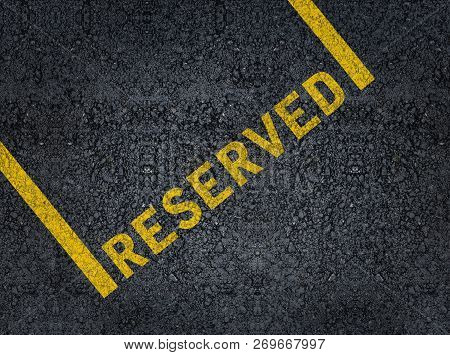 Word Reserved Written With Paint On Road Asphalt