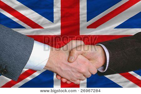 Businessmen Handshake After Good Deal In Front Of Uk Flag