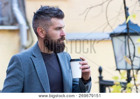 Hipster Hold Paper Coffee Cup And Enjoy Park Environment. Relaxing Coffee Break. Drink It On The Go.
