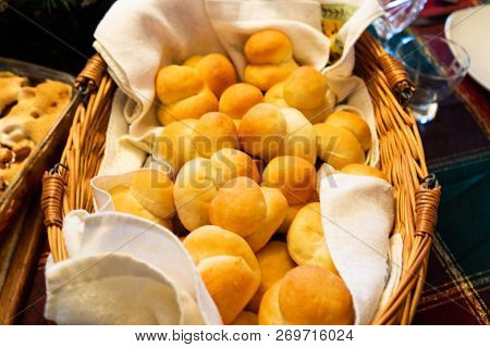 Traditional Mennonite Zwieback Bread Rolls In Basket On Holiday Table