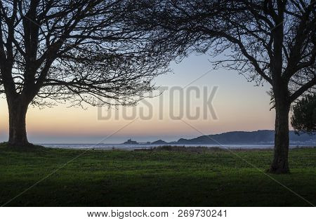 Dawn At Mumbles Headland The Iconic Mumbles Headland Taken From Blackpill Promenade, Swansea, Uk