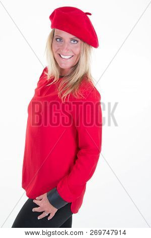 Middle Aged Forties Blond Beautiful Model Woman Posing In Studio In Red Clothes Sweater And Hat Bere