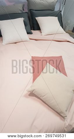 White Pillows On A Pink Bed In Home Bedroom