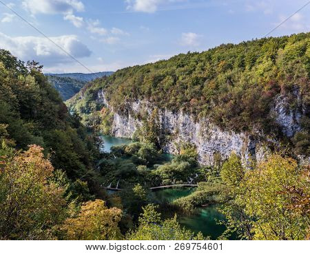 Cascading lakes with emerald water and several waterfalls. Travel to Croatia on a sunny warm day. The concept of ecological and active tourism