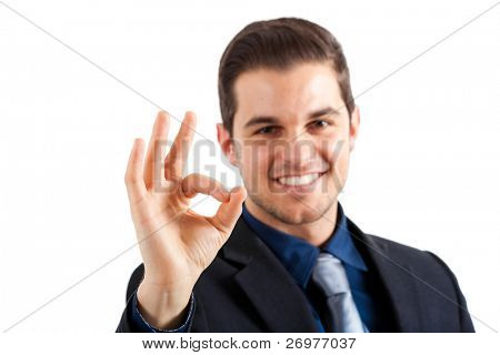 Young businessman doing the ok sign with his hand