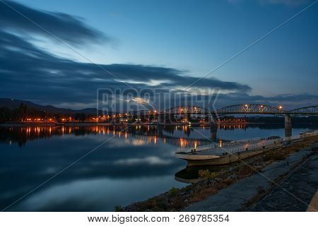 Scenic Nightscape Of Maria Valeria Bridge With Reflection In Danube River, Esztergom, Hungary At Ear