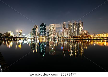 Modern Night City Skyline With Lights Reflection