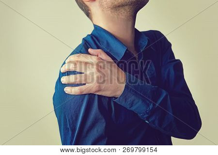 Closeup Of Young Man With Shoulder Pain, Upper Arm Pain, People With Body-muscles Problem, Healthcar