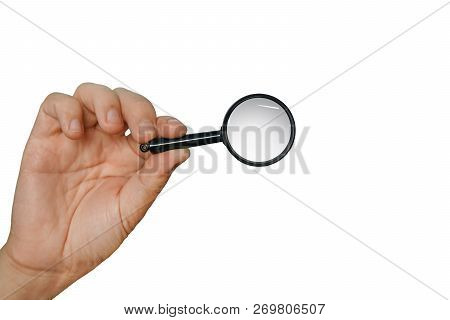 Magnifying Glass In A Hand Isolated On A White Background. Concept Of Searching, Looking Through Mag