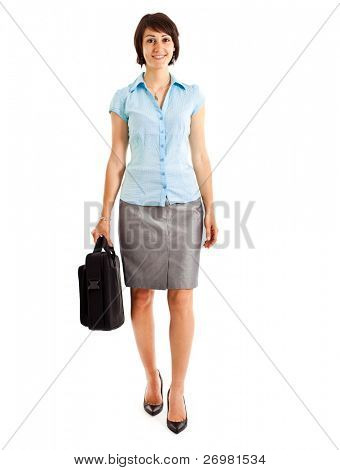 Full length image of confident business woman holding a briefcase