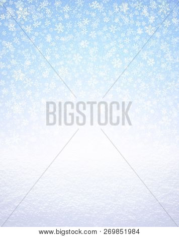 Snowflakes Shapes On An Icy Blue Background, Falling On A White Snow Covered Ground. Winter Seasonal