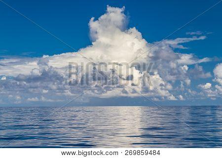 Calm Sea Ocean Blue Sky Background. Zen Background, Inspirational Sky Clouds Background. Natural Sun