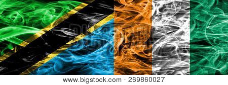 Tanzania Vs Ivory Coast Smoke Flags Placed Side By Side. Thick Colored Silky Smoke Flags Of Tanzania