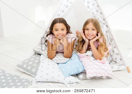 Girlish Leisure. Sisters Friends Share Gossips Having Fun At Home. Pajamas Party For Kids. Siblings