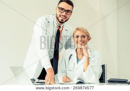 Happy Doctor Portrait With Work Partner.