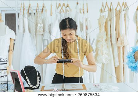 Portrait Of Happy Asian Woman Wedding Dress Store Owner Is Working,beautiful Dressmaker In Shop And