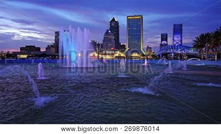 Jacksonville, Florida - June 17th: Water Fountain And Downtown Jacksonville Skyline At Sunset In Jac
