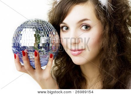 Picture of a beautiful girl, who keeps the ball in the form of the planet Earth in the hands of