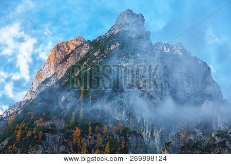 Panorama Of Dachstein Mountains Peaks With Sunset Light Austria. Peaks Covered With Clouds. Location