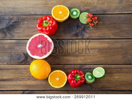 Products Containing Vitamin C On Wooden Background. Word C Made From Fruits And Vegetables Rich In V
