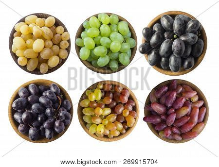 Grapes In A Wooden Bowl Isolated On White Background. Blue, Yellow, Red And Green Grapes On White Ba