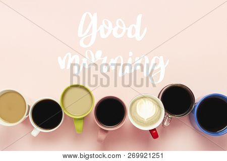 Many Multicolored Cups Of Coffee And Coffee Drinks Set In Line On A Pink Background With The Text Go